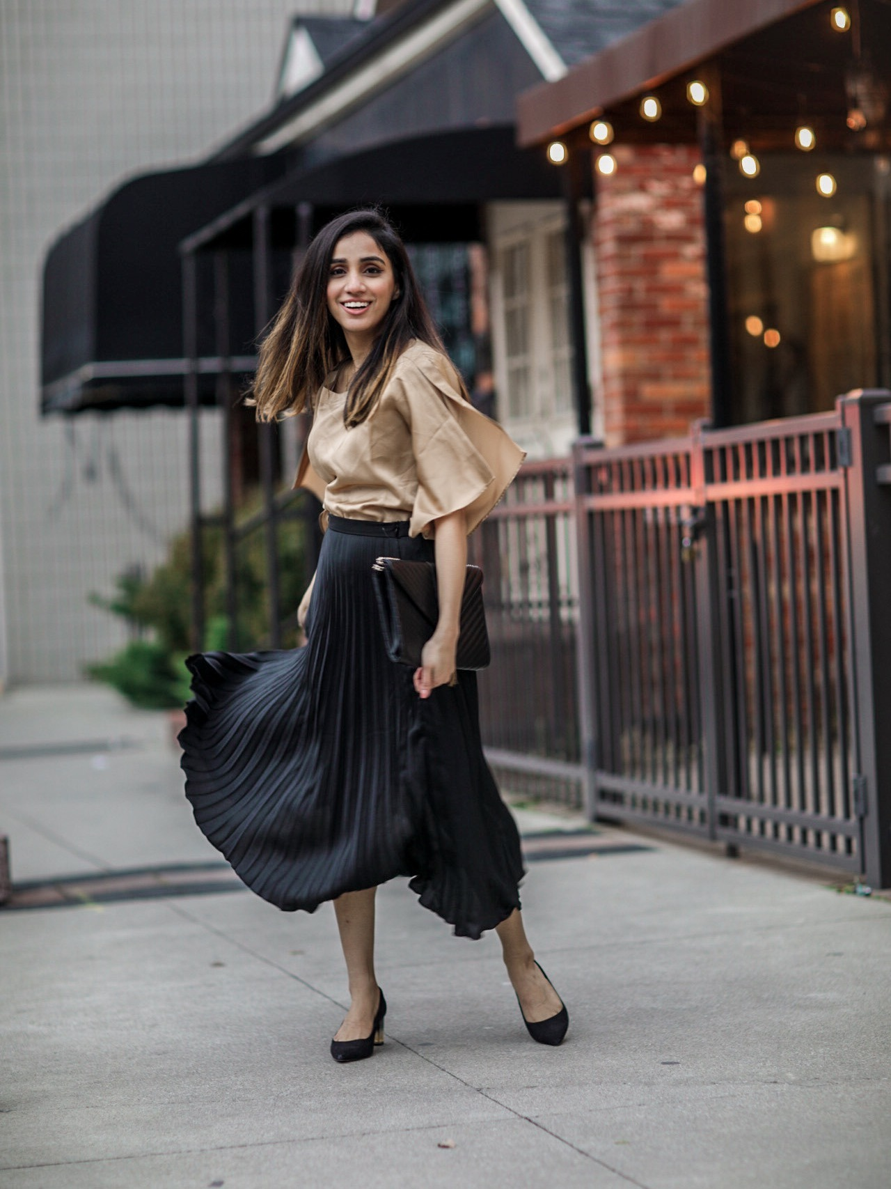 Holiday Outfits Roundup 2019 black pleated skirt fluid satin slit-sleeve blouse Faiza Inam 1