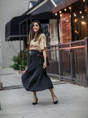 Holiday Outfits Roundup 2019 black pleated skirt fluid satin slit-sleeve blouse Faiza Inam 2