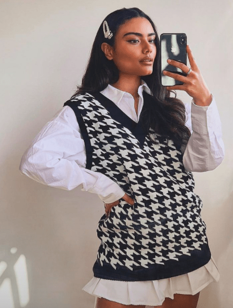 TikTok Fashion Trends We Are All Obsessing Over white mini pleated skirts oversized sweater vests 1