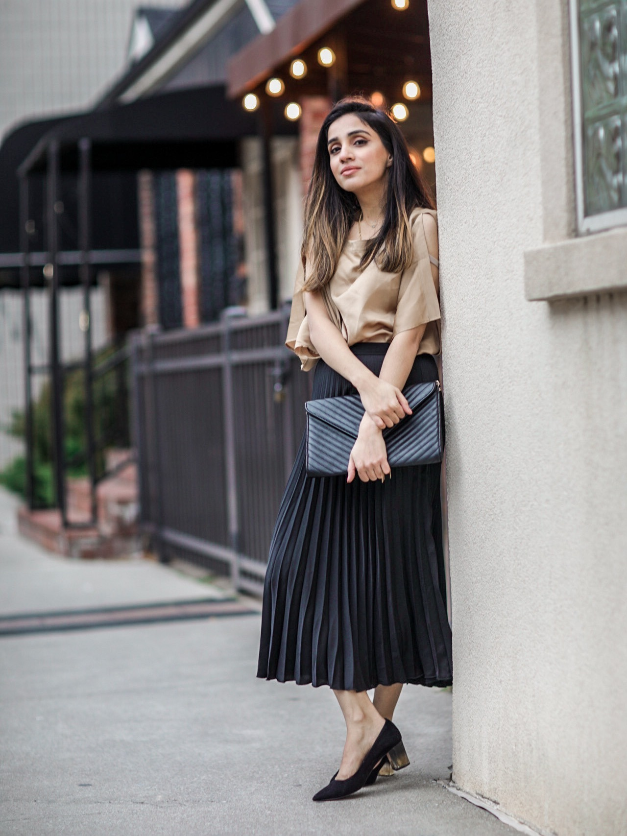 What to Wear at Thanksgiving Family Dinner pleated skirt black silk blouse 1